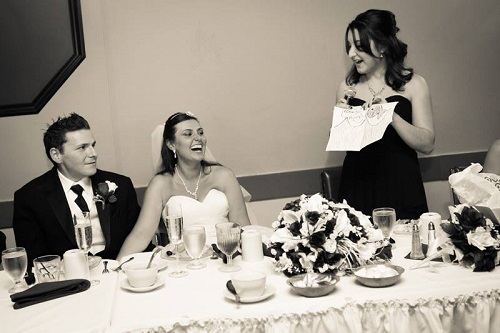 Taylor giving the Maid of Honor speech at my wedding. It was epic. Can't believe we'll be switching roles in just two weeks!