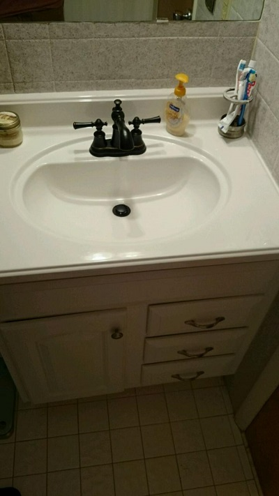 New vanity and faucet. Next up will be repainting the vanity hardware black to match the faucet.